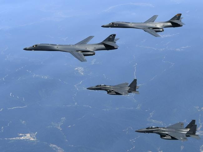 US Air Force B-1B bombers, top, and second from top, are regularly flying out of Guam to be joined by Japanese and South Korean fighter jets over the Korean Peninsula. Picture: South Korean Defense Ministry via AP