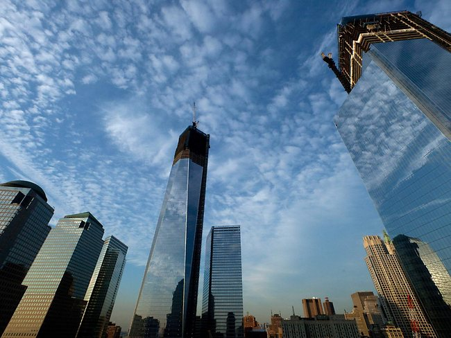 One World Trade Center, center, rises above the National September 11 Memorial and Museum at the World Trade Center.