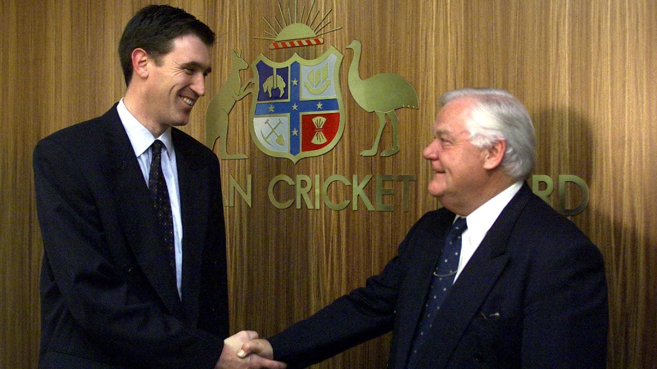 Australian Cricket Board chairman Denis Rogers shakes hands with newly appointed CEO James Sutherland in 2001. Photo: Colin Murty