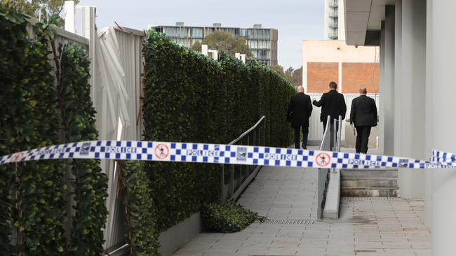 A buckled fence behind police lines at the Zetland block where Shuyu Zhou was found dead. Picture: Damian Shaw