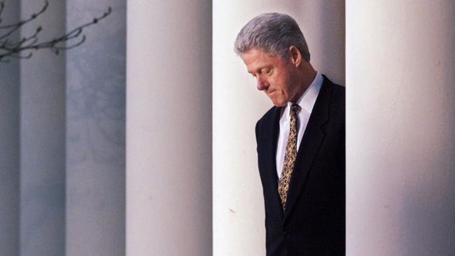 US President Bill Clinton walks to the White House's Rose Garden podium to deliver a short statement to the media on the impeachment inquiry.