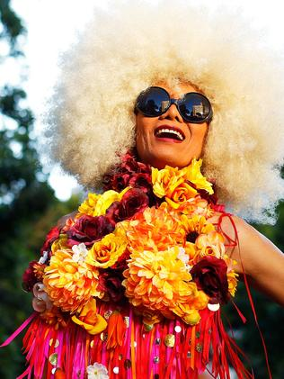 A parade goer poses prior to the start of the parade. Picture: Getty