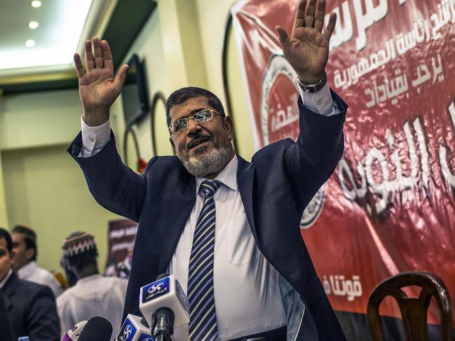Egyptian presidential candidate Mohamed Morsi of the Muslim Brotherhood addresses supporters at a press conference on June 13, 2012 in Cairo, Egypt. Picture: Daniel Berehulak/Getty