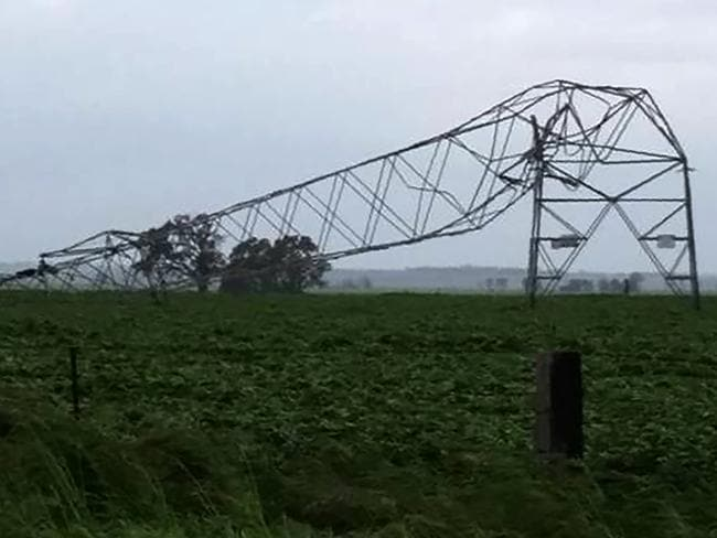 One of the transmission towers carrying power lines, which was toppled by high winds near Melrose in South Australia. Picture: Debbie Prosser/AFP