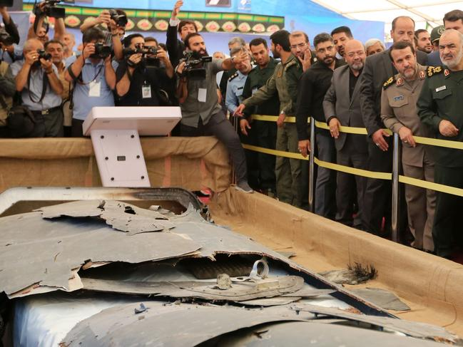 Debris from what Iran presented as a downed US drone reportedly recovered within Iran's territorial waters, at Tehran's Islamic Revolution and Holy Defence museum. Picture: AFP