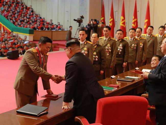 Kim Jong-un awards scientists in the field of national defence for their success in the Hwasong-15 ICBM test launch. Picture: KCNA/AFP