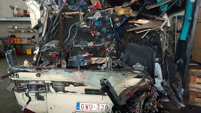 The wreckage of a tourist bus from Belgium is seen at a hangar of the maintenance center of the motorway A9, in Sierre, western Switzerland, Wednesday, March 14, 2012. The bus carrying Belgian students returning from a ski holiday crashed into a wall in a Swiss tunnel, killing 22 Belgian 12-year-olds and six adults, police said Wednesday. (AP Photo/Keystone,Laurent Gillieron)