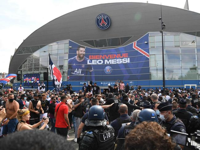 There were crazy scenes in Paris as Messi arrived in the city. (Photo by Bertrand GUAY / AFP)