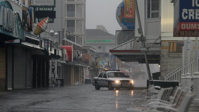 A police car patrols a boardwalk in Ocean City as Hurricane Irene heads toward the Maryland coast.Picture: Patrick Semansky / AP