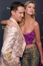 Model Stella Maxwell walks the red carpet with designer Jeremy Scott and seems unaware of her apparent nip slip. Picture: Splash News