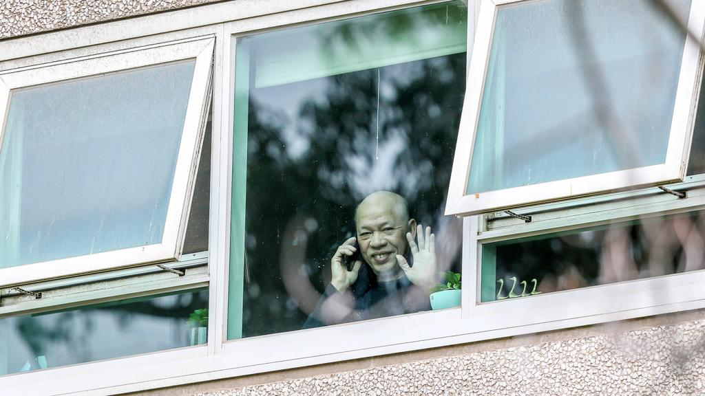 A resident waves and makes a phone call. Picture: Tim Carrafa