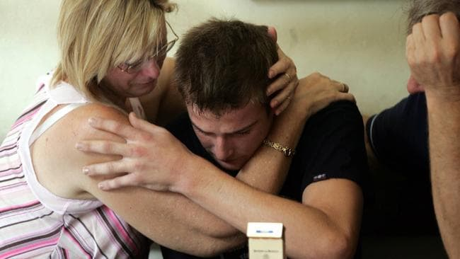 Czugaj, 19, weeps openly as his parents visit him for the first time at Police Headquarters in Denpasar.