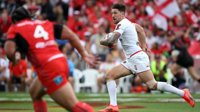 Gareth Widdop of England makes a break.