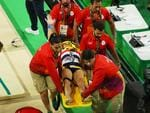 Medical teams assist France's Samir Ait Said after his horror leg break while competing on the vault during the artistic gymnastics men's team qualification.