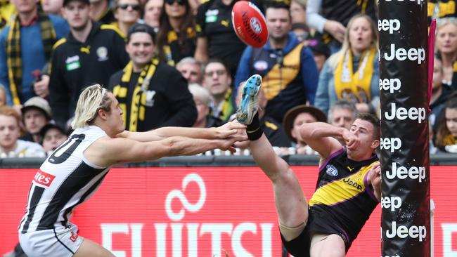 Richmond's Jack Higgins kicks an amazing goal .Pic: Michael Klein