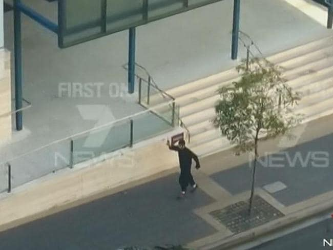 The moment Parramatta shooter, 15-year-old Farhad Khalil Mohammad Jabar started firing a gun in front of a police station killing accountant Curtis Cheng, before being shot dead himself. Picture: Channel 7