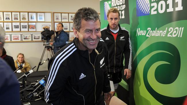 All Blacks assistant coach Wayne Smith and halfback Jimmy Cowan leave a press conference in 2011.