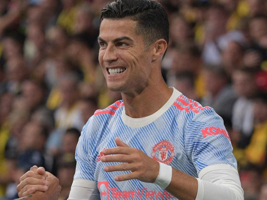 Manchester United's Portuguese striker Cristiano Ronaldo celebrates after scoring a goal during the UEFA Champions League Group F football match between Young Boys and Manchester United at Wankdorf stadium in Bern, on September 14, 2021. (Photo by SEBASTIEN BOZON / AFP)