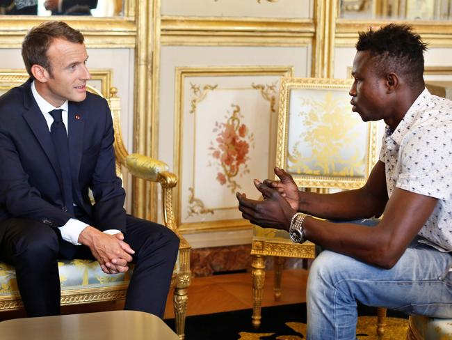 French President Emmanuel Macron speaks with Mamoudou Gassama from Mali, at the presidential Elysee Palace in Paris. Picture: AFP/Thibault Camus