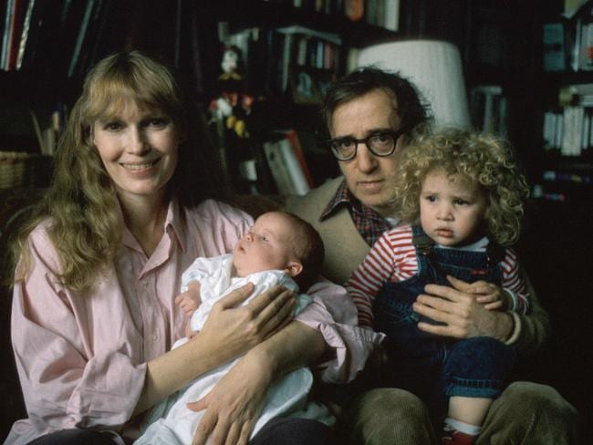 In this childhood photo, Dylan Farrow sits on Woody Allen's knee as her mother Mia Farrow holds her baby son Satchel, who now goes by the name Ronan.