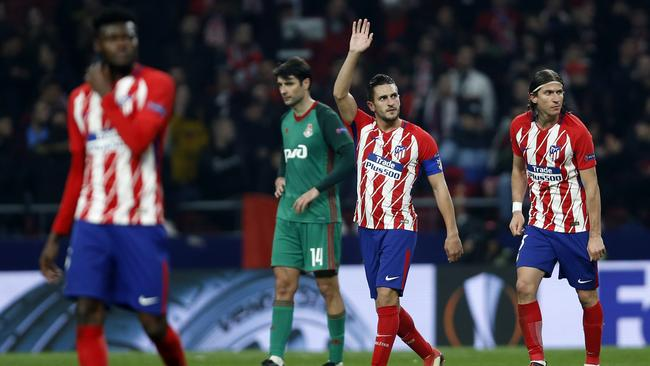 Atletico Madrid's Koke, center, greets supporters after scoring his side's third goal