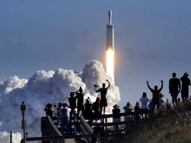 The crowd cheers at Playalinda Beach during the successful launch of the SpaceX Falcon Heavy rocket on February 6, 2018. Picture: Joe Burbank
