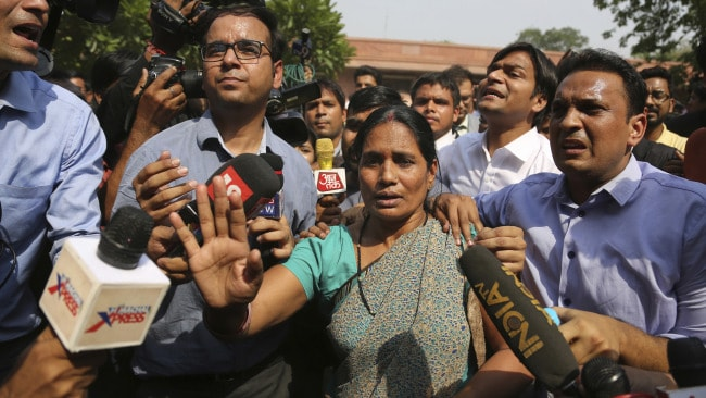 Asha Devi, mother of the victim of the fatal 2012 gang rape, after the Supreme Court verdict in the case. Image: AP.