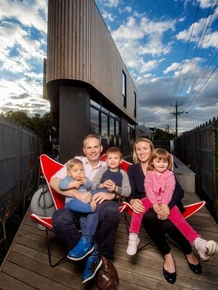 Richard Gittins and Nicole de Spa and their kids Jack, 4, Madeleine, 2, and harry, 10 months, with their triangular home. Picture: Jay Town