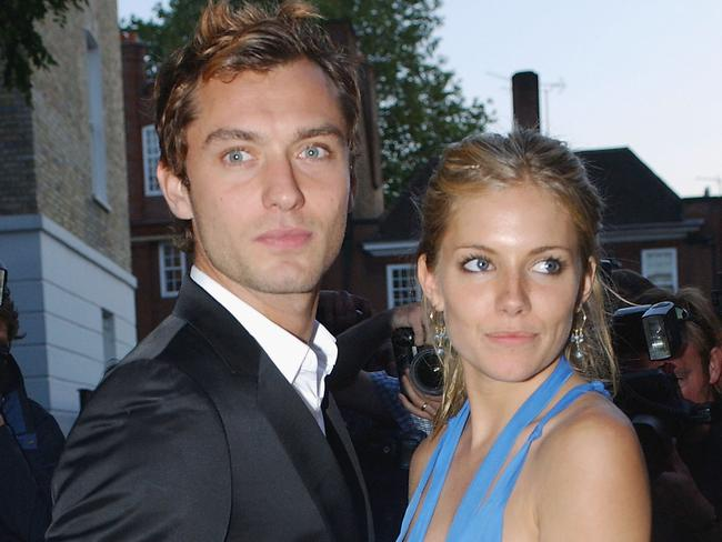It was the on-again off-again relationship the media couldn't get enough of. Sienna Miller pictured with Jude Law in 2004. Picture: Steve Finn/Getty Images
