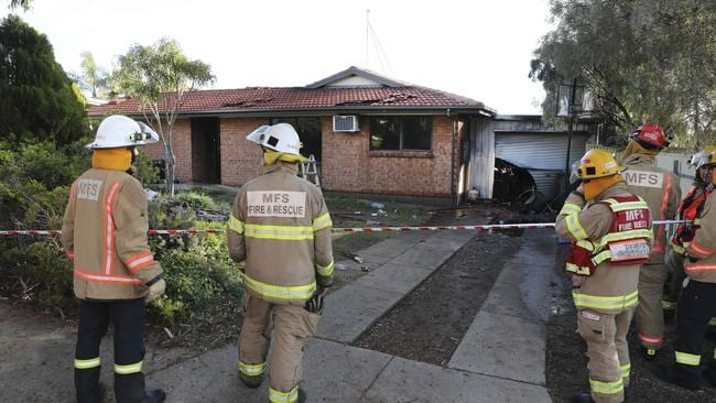 MFS firefighters at the Darlington home, which was destroyed by fire. Picture: AAP / Dean Martin