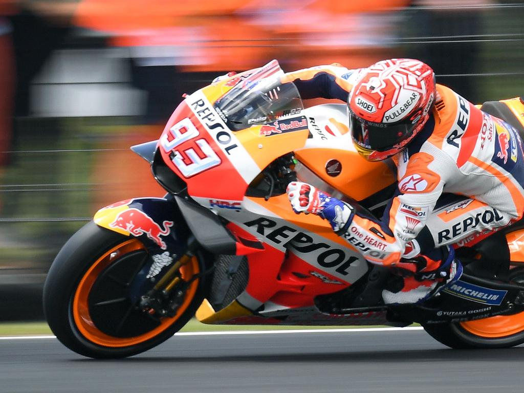 Repsol Honda Team's Spanish rider Marc Marquez speeds through a corner during the third Moto3 practice session at the Phillip Island circuit on October 27, 2018, ahead of the MotoGP Australian Grand Prix on October 28. (Photo by William WEST / AFP) / -- IMAGE RESTRICTED TO EDITORIAL USE - STRICTLY NO COMMERCIAL USE --