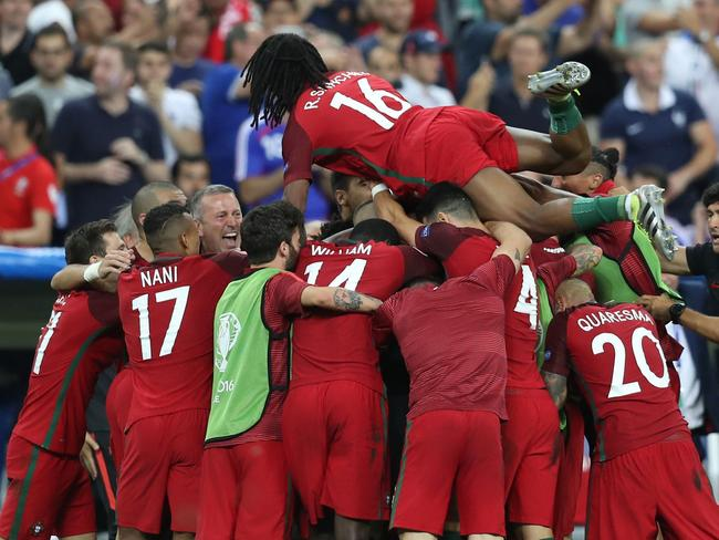Portugal's players celebrate after scoring.
