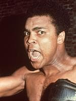 American boxer Muhammad Ali, former World Heavyweight Champion, shouting while wearing boxing gloves circa 1963. (Photo by Hulton Archive/Getty Images)