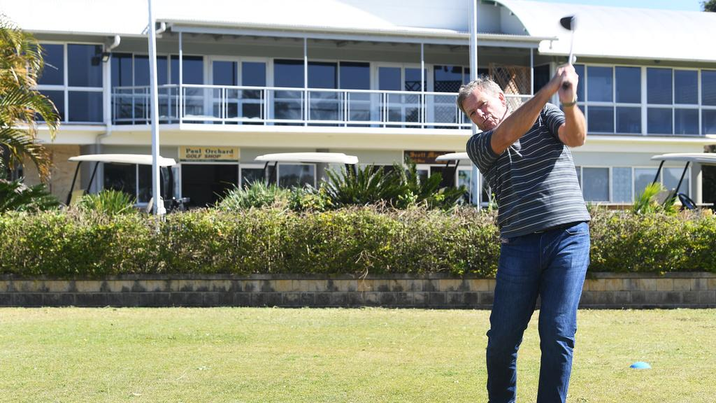 New co-owner of the Gympie golf course site, Phil Goodman, works on his swing.