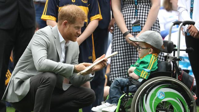 Harry chats with a young fan. Picture: Chris Jackson/Pool/Getty Images