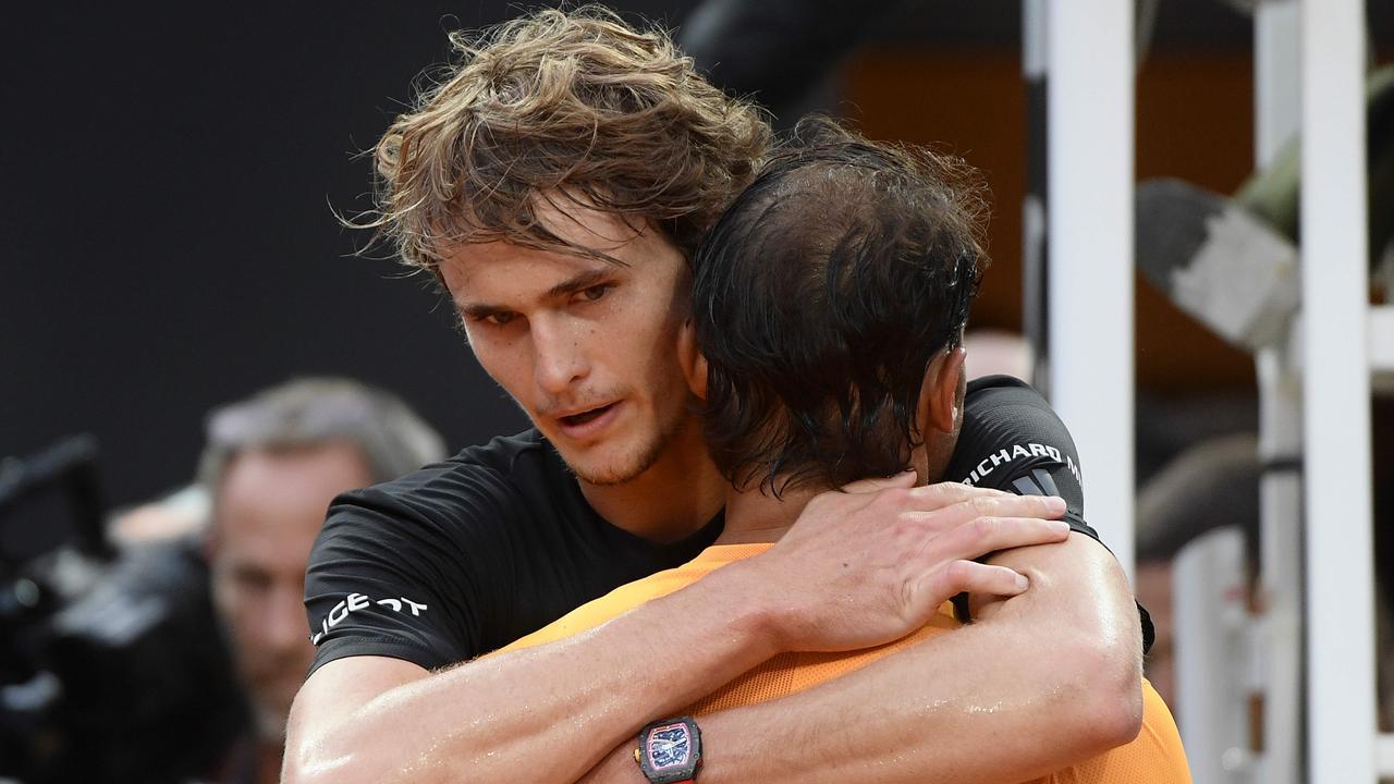 Rafael Nadal is congratulated by Alexander Zverev.