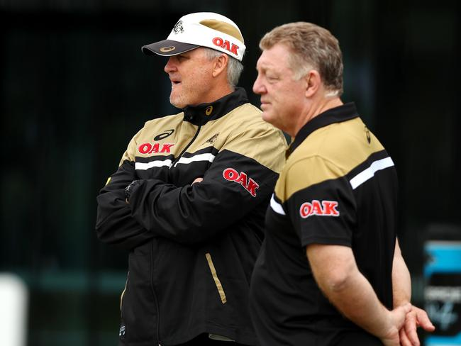 Anthony Griffin and Phil Gould watch on during Penrith Panthers training.