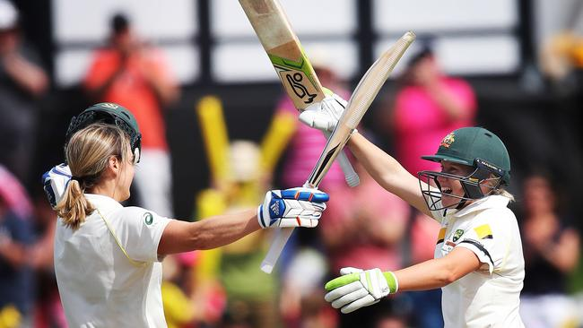 Australian Ellyse Perry celebrates her century with Alyssa Healy during Day 3 of Women's Ashes Test match between Australia and England at North Sydney Oval. Picture: Phil Hillyard