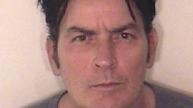 In this handout photo provided by the Aspen Police Department, Charlie Sheen is pictured after being arrested on December 25, 2009 in Aspen, Colorado. Image: Handout / Getty
