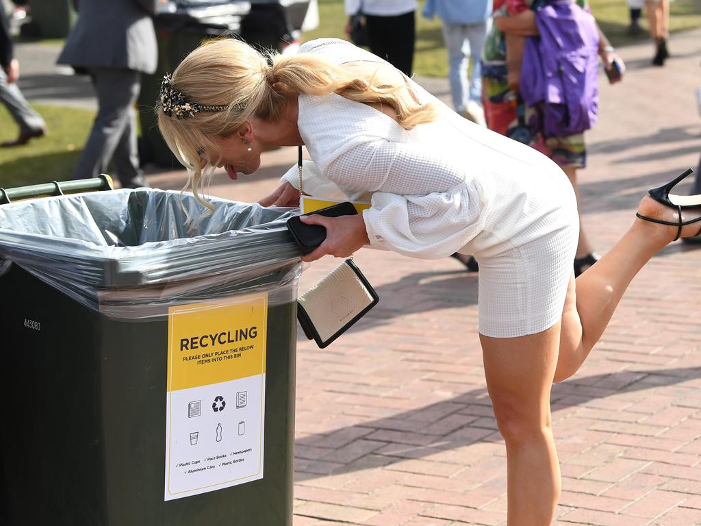 A woman pretends to vomit into a bin. Charming. Picture: Julian Smith/AAP