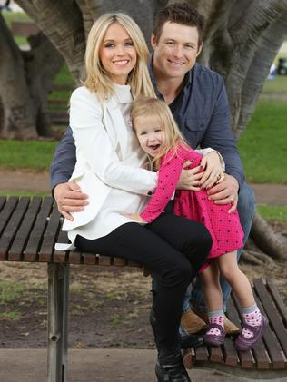 Channel 7 weather presenter Sarah Cumming is pregnant with second child. Pictured at Rose Bay with husband Stuart Dew and daughter Frankie Dew (2). Photo: Bob Barker.