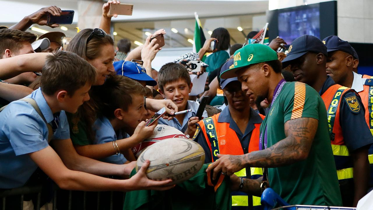 Springboks fly half Elton Jantjies signs a rugby jersey at the OR Tambo International Airport.