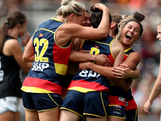 203a6acf94 Crows players celebrate an Eloise Jones goal during the 2019 AFLW Grand  Final match between Adelaide and Carlton at Adelaide Oval in front of  53,034 people.