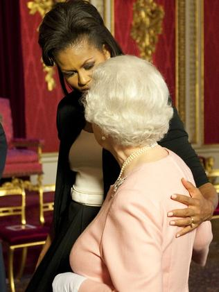 Cuddling is also a royal no-no but the Queen instigated this hug with Michelle Obama in 2009. Picture: AP Photo/Daniel Hambury