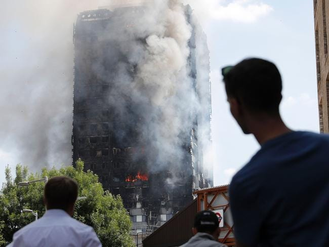 Shaken survivors have told of seeing people trapped in burning units or leaping from windows to escape the flames as they raced towards the building upper floors. Picture: Adrian Dennis/AFP