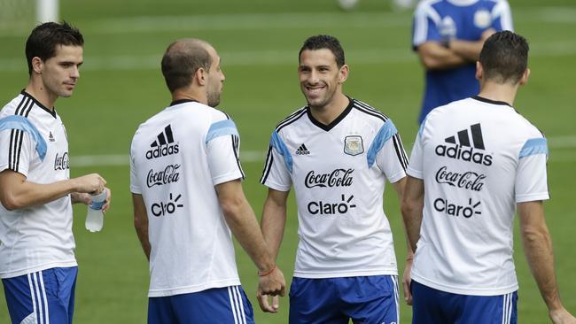 Argentine players, from left, Fernando Gago, Pablo Zabaleta, and Maxi Rodriguez.