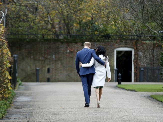 Britain's Prince Harry and Meghan Markle walk away after posing for the media. Picture: AFP/Daniel Leal-Olivas