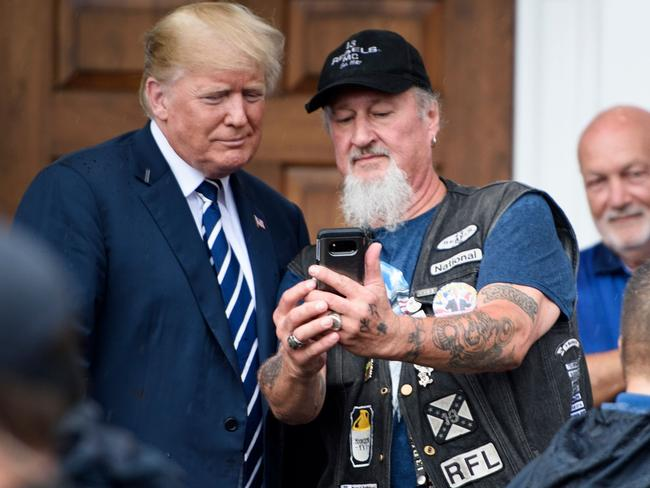 US President Donald Trump takes a selfie with a supporter during the Bikers for Trump event. Picture: Brendan Smialowski / AFP