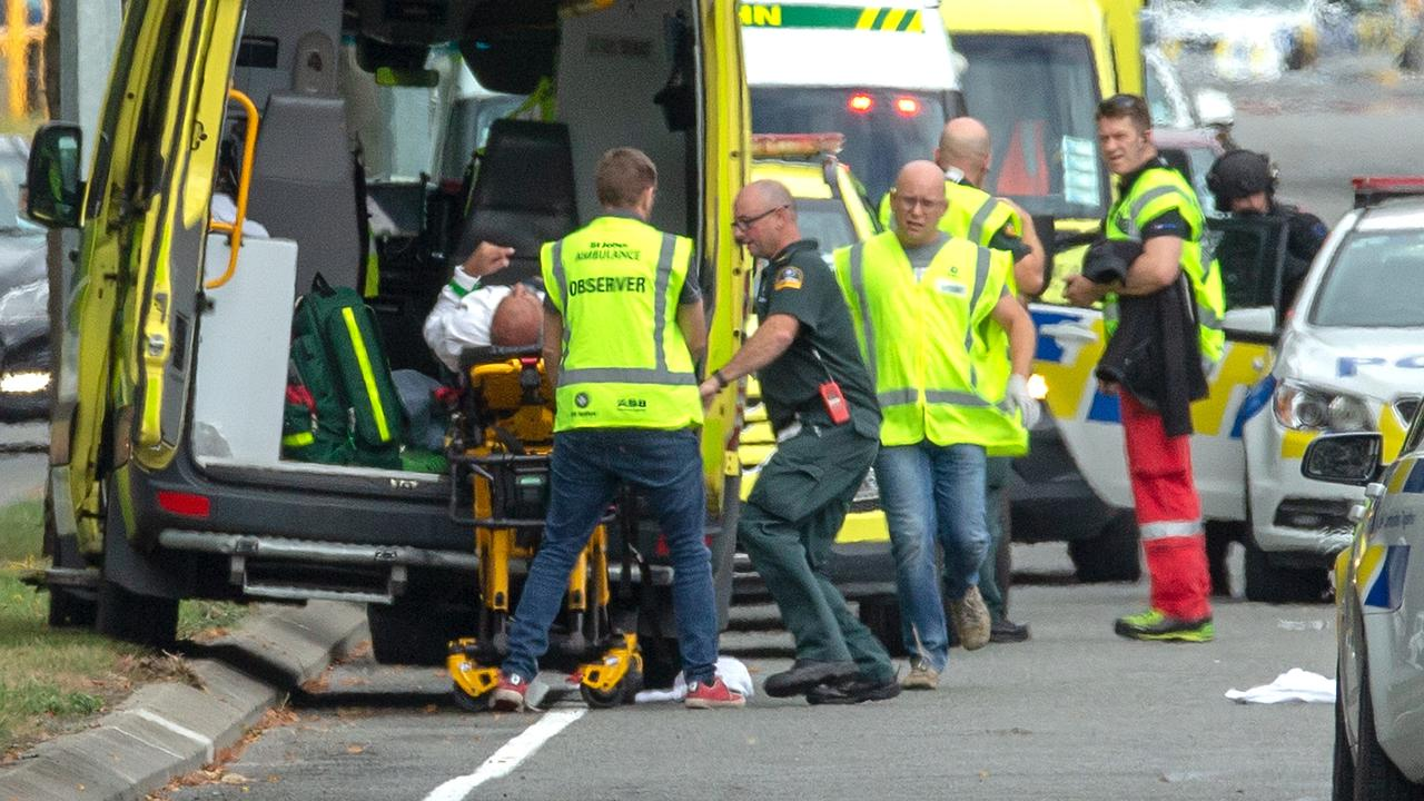 An injured person is treated by ambulance following the attack.