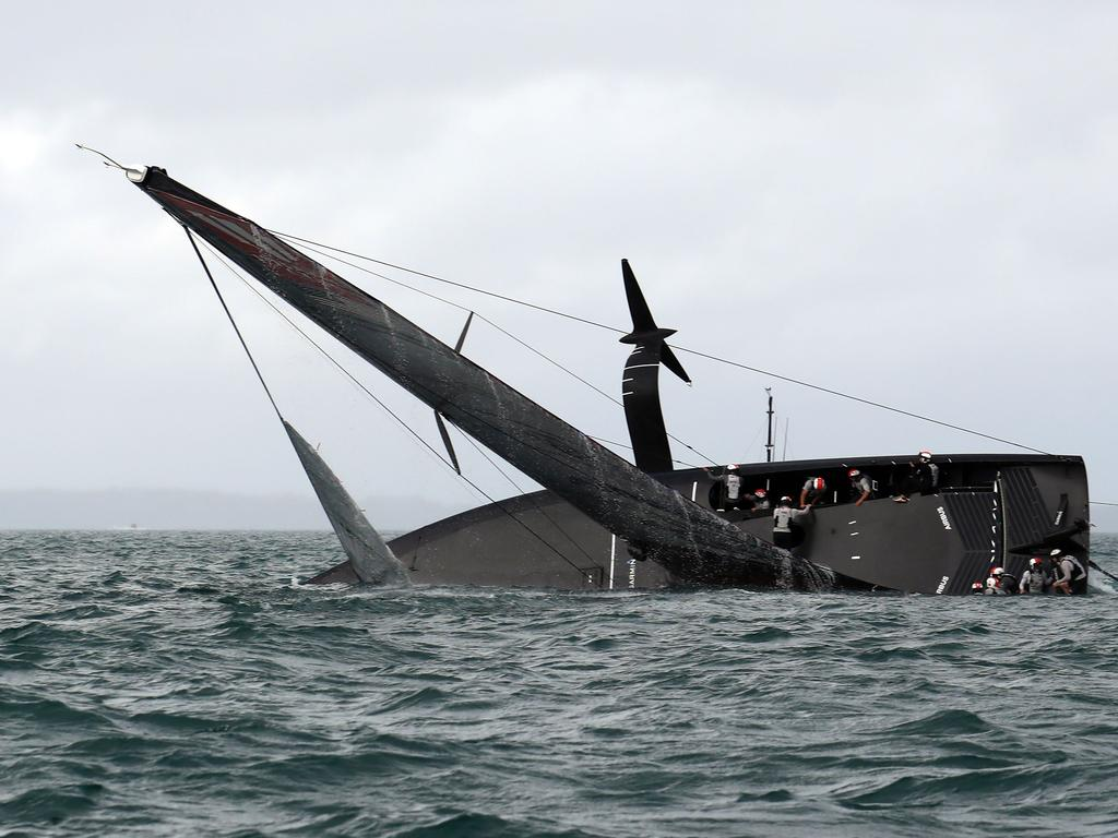New York Yacht Club American Magic capsizes during Round Robin two, Race three against Luna Rossa Prada Pirelli of the Prada Cup 2021, the  challengers series of the 36th America's Cup in Auckland on January 17, 2021. (Photo by Gilles Martin-Raget / AFP)